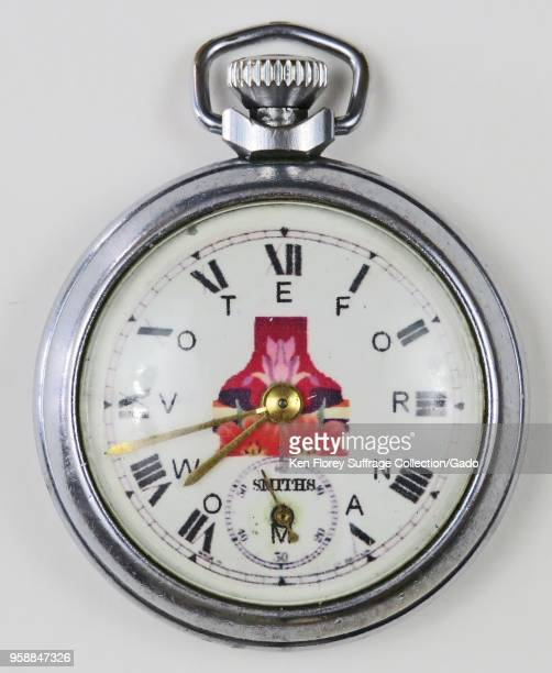 "Silvercolored prosuffrage pocket watch or fob watch with the phrase 'Vote for Woman "" with each letter corresponding to a Roman numeral and a red..."