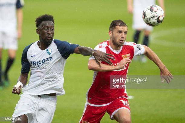 Silvere Ganvoula of VfL Bochum and Ken Reichel of 1.FC Union Berlin battle for possession during the Second Bundesliga match between VfL Bochum 1848...