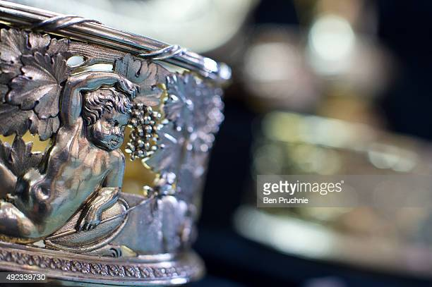 Silver-gilt wine coaster bearing the Royal Arms is displayed during the Paul Storr Regency Silverware Exhibition at Koopman Rare Arts on October 12,...