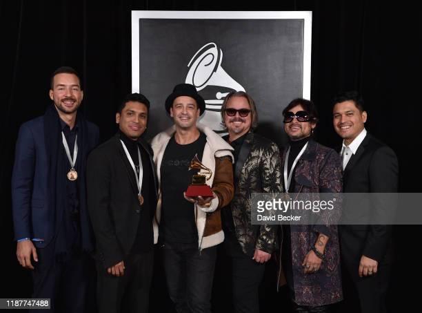 Silverio Lozada David Julca Julio Briceno Jose Rafael Torres Servando Primero and Jonathan Julca pose with the Best Alternative Song award backstage...