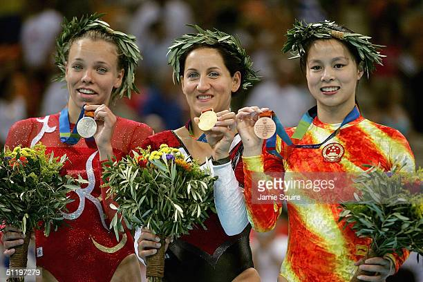 Silvermedalist Karen Cockburn of Canada gold medalist Anna Dogonadze of Germany and bronze medalist Shanshan Huang of China pose with their medals...