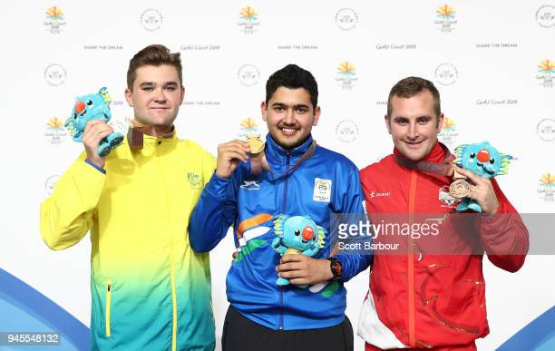 SilverÊmedalist Sergei Evglevski of Australia gold medalist Anish of India and bronze medalist Sam Gowin of England pose during the medal ceremony...