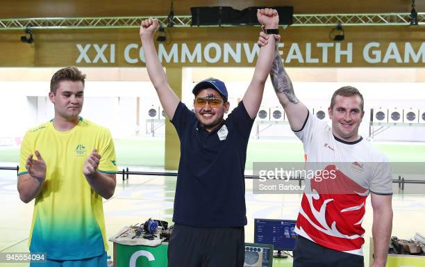 SilverÊmedalist Sergei Evglevski of Australia, gold medalist Anish of India and bronze medalist Sam Gowin of England celebrate after the 25m Rapid...