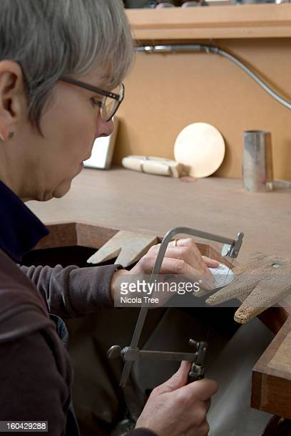 silversmith working in her studio
