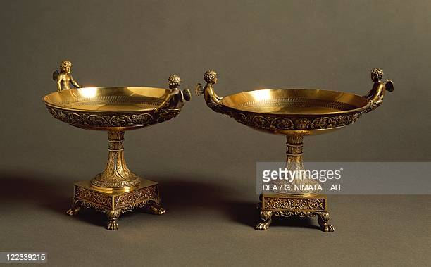 Silversmith's Art France 19th century AlbertErnest CarrierBelleuse Pair of gilded silver cakestands with mythological decoration moulded band with...