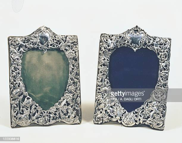 Silversmith's Art Great Britain 19th century Pair of heart shaped decorated silver photoframes with vegetable volutes and puttos
