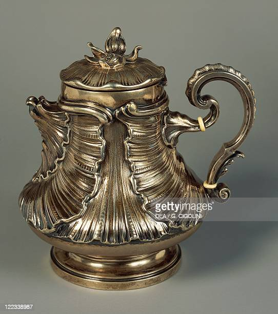 Silversmith's Art Italy 20th century Mario Buccellati Silver chocolate jug with embossed leaves and flowershaped knob based on the drawing of the...