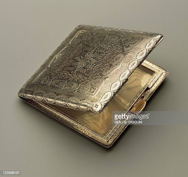 Silversmith's Art Italy 20th century Mario Buccellati Silver cigarette case with gold button and hinged cover ornated with an engraving depicting a...