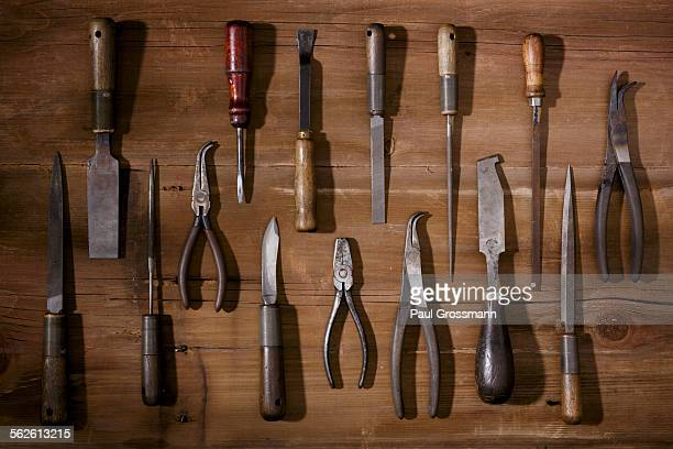 Silversmiths tools arranged on workbench