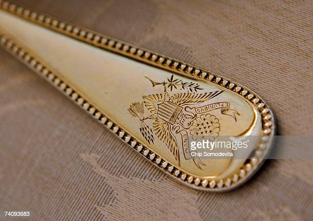 Silverwear etched with the presidential seal sits at the place settings for Queen Elizabeth II in advance of the state dinner in her honor in the...