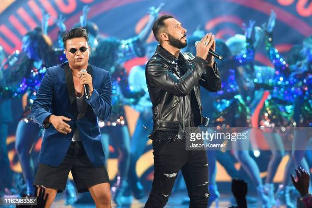 Silvestre Dangond and Cedric Gervais perform on stage during Premios Juventud 2019 at Watsco Center on July 18 2019 in Coral Gables Florida