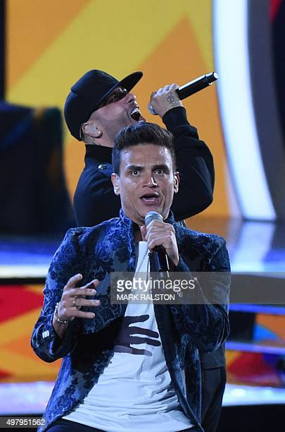 Silvestre Dangond and Nicky Jam perform during the 16th Annual Latin Grammy Awards on November 19 in Las Vegas Nevada AFP PHOTO/MARK RALSTON