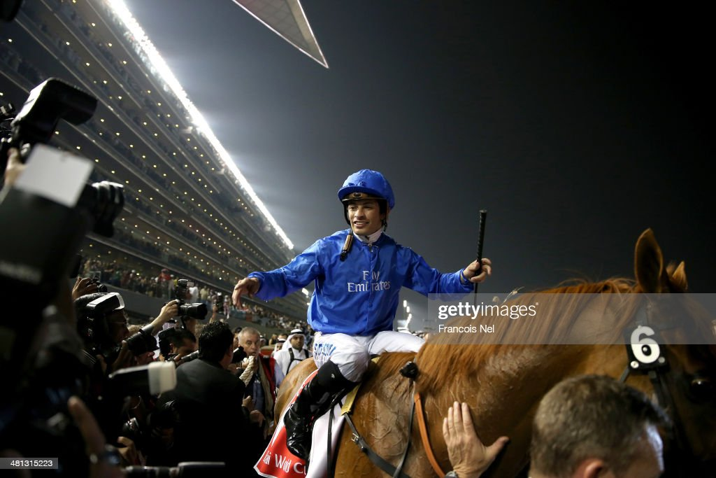 Silvestre De Sousa celebrates riding African Story to victory to win the Dubai World Cup at the Meydan Racecourse on March 29, 2014 in Dubai, United Arab Emirates.