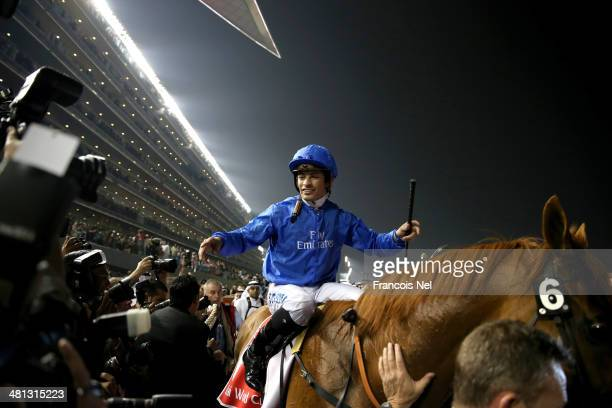 Silvestre De Sousa celebrates riding African Story to victory to win the Dubai World Cup at the Meydan Racecourse on March 29 2014 in Dubai United...