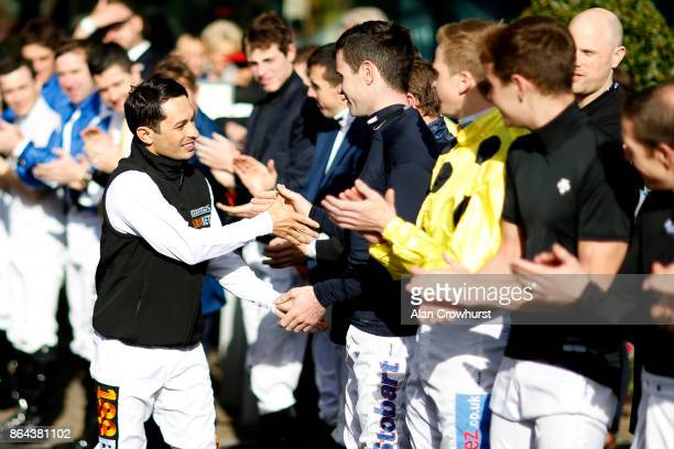 Silvestre De Sousa is congratulated after being crowned Champion Jockey at Ascot racecourse on QIPCO British Champions Day on October 21 2017 in...