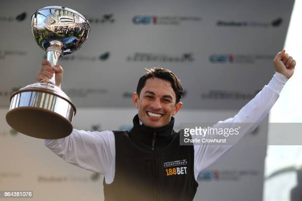 Silvestre de Sousa of Brazil celebrates being crowned champion flat jockey of the season at Ascot racecourse on QIPCO British Champions Dat on...
