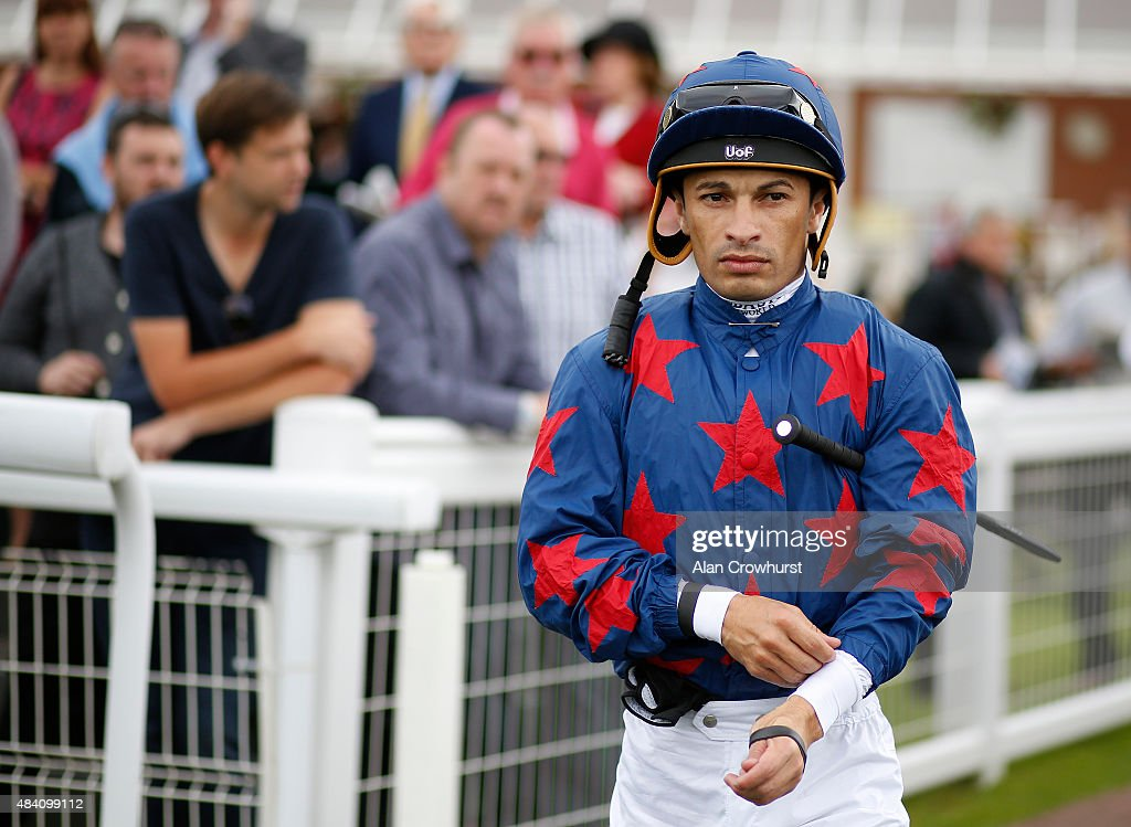 Silvestre De Sousa poses at Newbury racecourse on August 15, 2015 in Newbury, England.