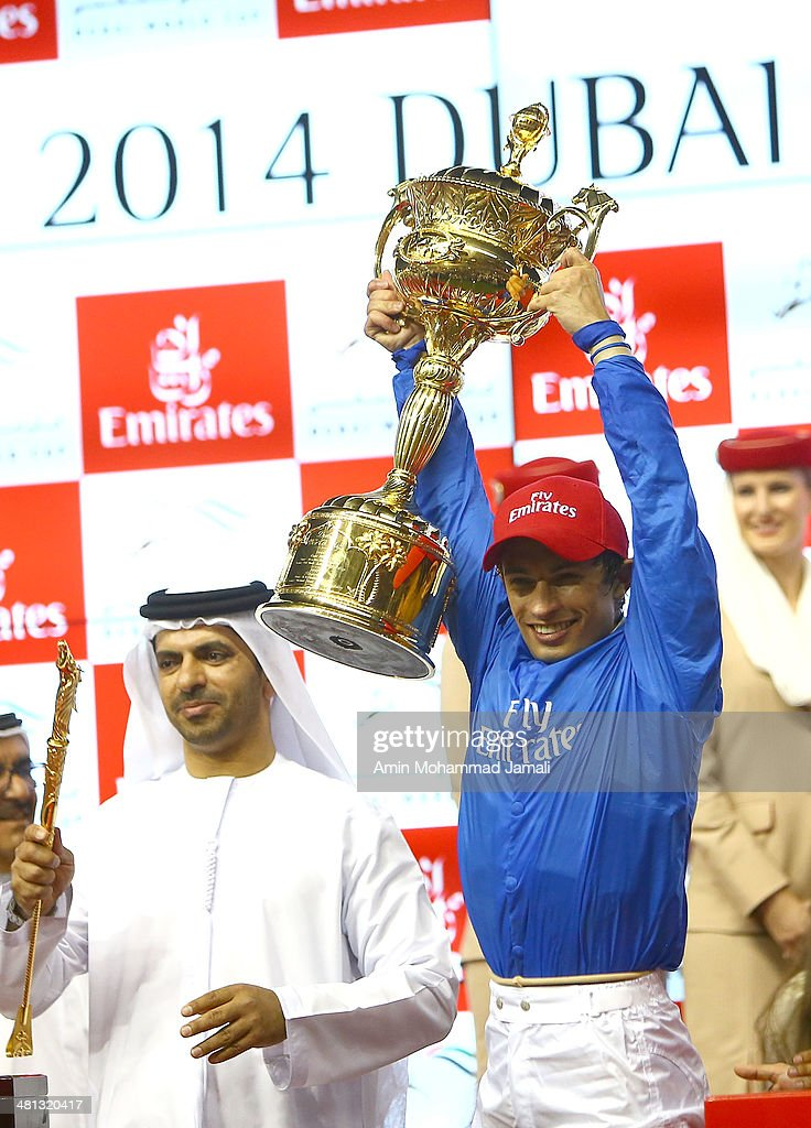 Silvestre De Sousa rejoices after winning the Dubai World Cup with his horse African Story during the Dubai World Cup at the Meydan Racecourse on March 29, 2014 in Dubai, United Arab Emirates.
