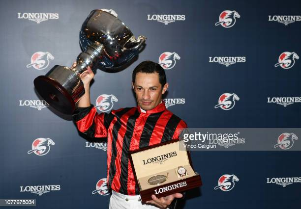 Silvestre De Sousa representing Great Britain poses with the trophy after winning championship during the LONGINES International Jockeys'...