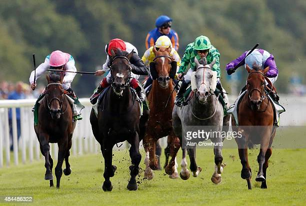 Silvestre De Sousa riding Arabian Queen win The Juddmonte International Stakes from Golden Horn and Frankie Dettori at York racecourse on August 19...