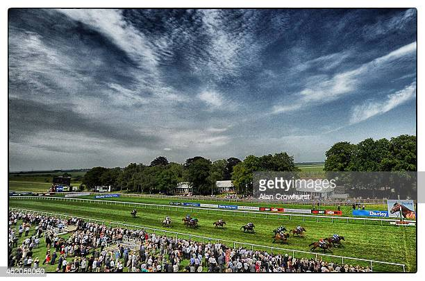 Silvestre De Sousa riding Golden Town win The Spa At Bedford Lodge Hotel MIle at Newmarket racecourse on July 12 2014 in Newmarket England