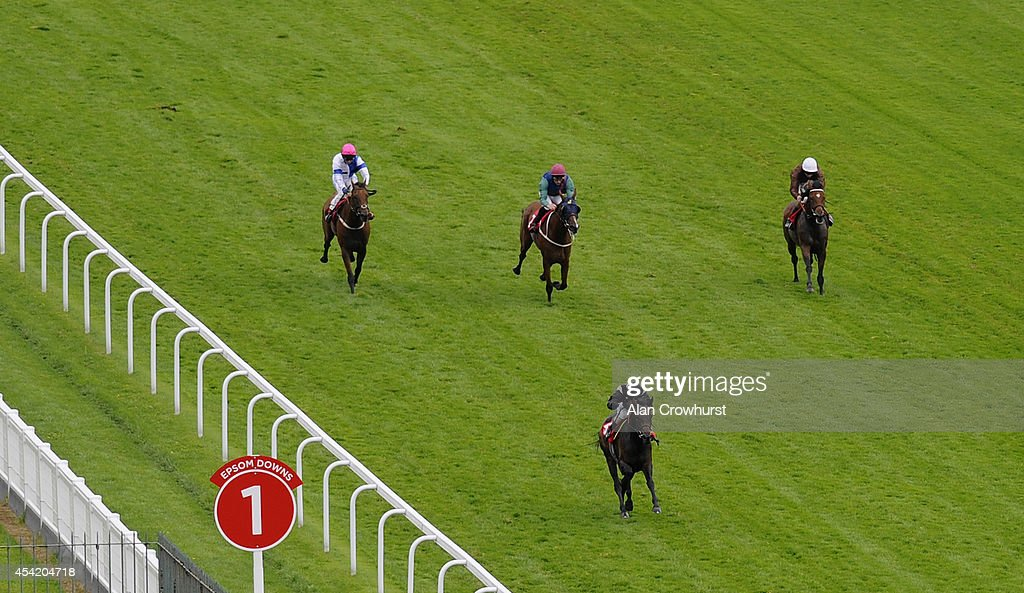 Silvestre De Sousa riding Last Echo win The Chantilly Handicap at Epsom racecourse on August 26, 2014 in Epsom, England.