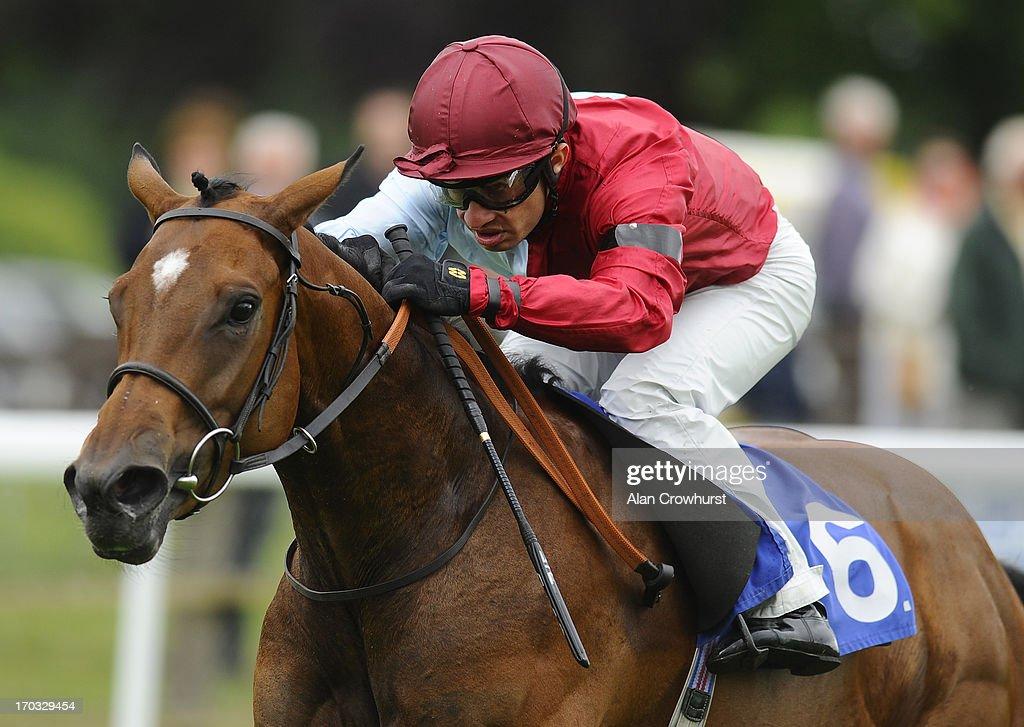 Silvestre De Sousa riding Lyric Ballad win The British Stallion Studs EBF Margadale Fillies' Handicap Stakes at Salisbury racecourse on June 11, 2013 in Salisbury, England.