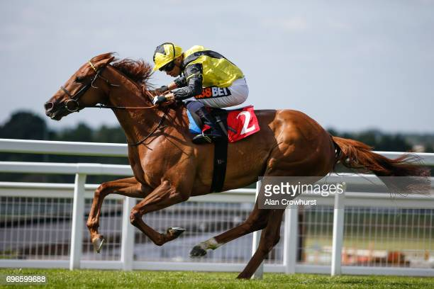 Silvestre De Sousa riding Shargiah win The George LindonTravers memorial Handicap Stakes at Sandown racecourse on June 16 2017 in Esher England