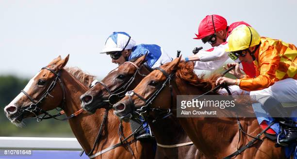 Silvestre De Sousa riding Tisbutadream win The Coral Distaff from Queen Of Time at Sandown Park racecourse on July 8 2017 in Esher England