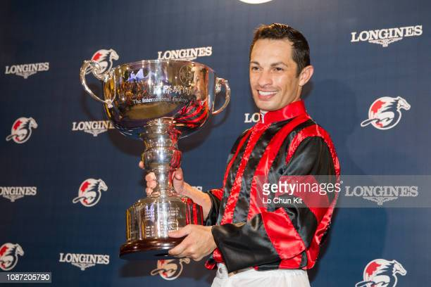 Silvestre de Sousa, winner of the LONGINES International Jockeys' Championship, celebrates his success at the presentation ceremony at Happy Valley...