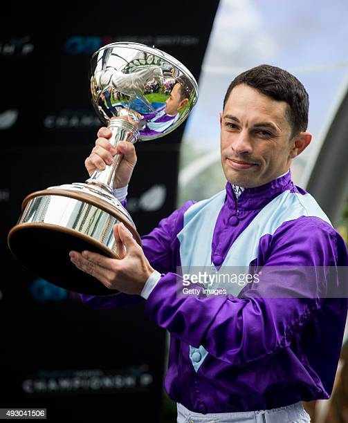 Silvestre De Sousa with the trophy after being crowned as Stobart Champion Flat Jockey during the QIPCO British Champions Day at Ascot Racecourse on...