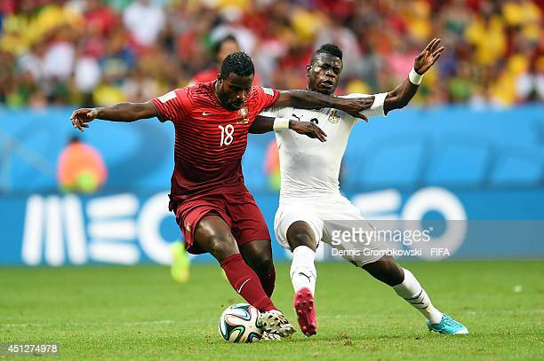 Silvestre Varela of Portugal and Acquah Afriyie of Ghana compete for the ball during the 2014 FIFA World Cup Brazil Group G match between Portugal...