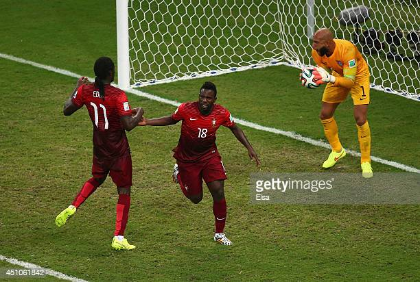 Silvestre Varela of Portugal celebrates scoring his team's second goal as goalkeeper Tim Howard of the United States looks on during the 2014 FIFA...