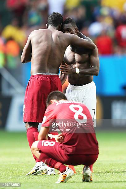 Silvestre Varela of Portugal hugs Christian Atsu of Ghana during the 2014 FIFA World Cup Brazil Group G match between Portugal and Ghana at Estadio...
