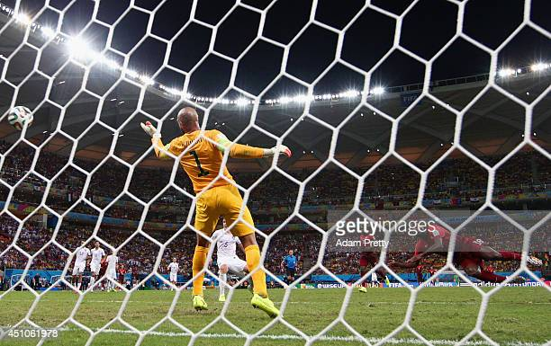 Silvestre Varela of Portugal scores his team's second goal on a header past Tim Howard of the United States during the 2014 FIFA World Cup Brazil...