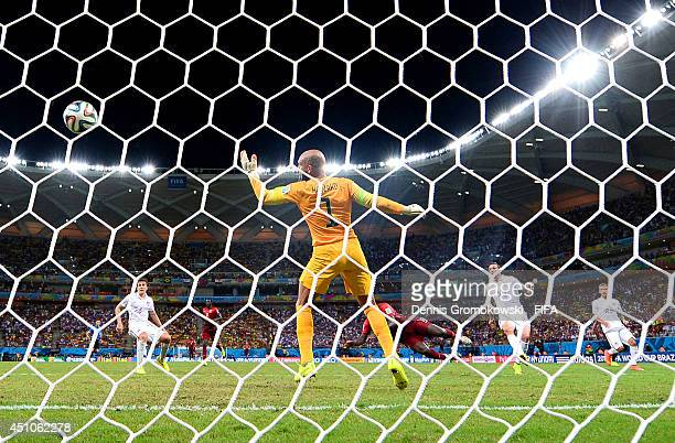 Silvestre Varela of Portugal scores the team's second goal past Tim Howard of the United States during the 2014 FIFA World Cup Brazil Group G match...