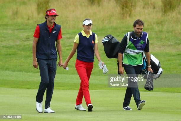 Silvia Banon of Spain and Pedro Oriol of Spain walk on the 12th hole during the team competition mixed foursomes stroke play during day four of the...