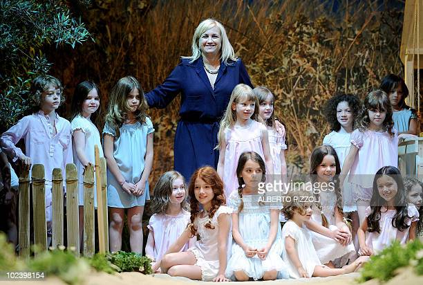 Silvia Fendi poses with Child models presenting clothes by fashion label Fendi during the Pitti Immagine Bimbo fashion fair on June 25 2010 in...