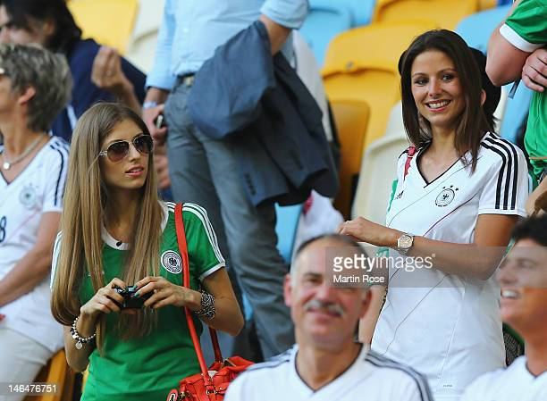 L'VIV UKRAINE JUNE 17 Silvia Meichel girlfriend of Mario Gomez and Cathy Fischer girlfriend of Mats Hummels look on prior to the UEFA EURO 2012 group...