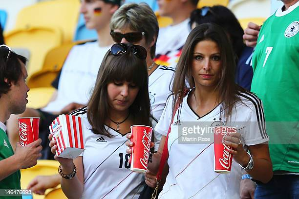 L'VIV UKRAINE JUNE 17 Silvia Meichel girlfriend of Mario Gomez and Jessica Farber girlfriend of Toni Kroos look on prior to the UEFA EURO 2012 group...