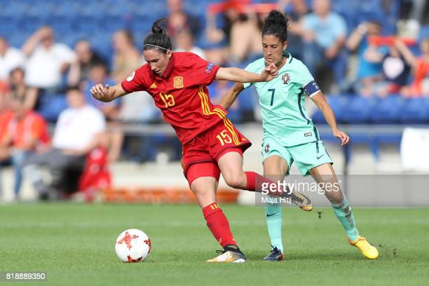 Silvia Meseguer of Spain and Claudia Neto of Portugal battle for the ball during the Group D match between Spain and Portugal during the UEFA Women's...