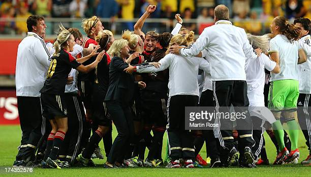 Silvia Neid head coach of Germany celebrate with her team after the UEFA Women's Euro 2013 semi final match between Sweden and Germany at Gamla...