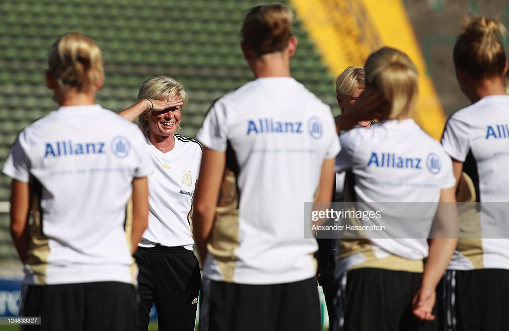 Silvia Neid (2nd L), head coach of team Germany talks to her players prior to a training session after the team presentation of the German Women's national team at Rosenau Stadium on September 13, 2011 in Augsburg, Germany.