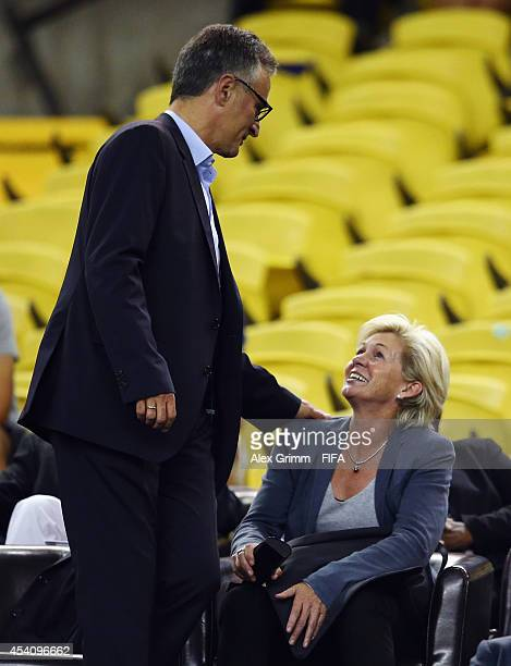 Silvia Neid head coach of the German women's team and DFB Secretary General Helmut Sandrock attend the FIFA U20 Women's World Cup Canada 2014 final...