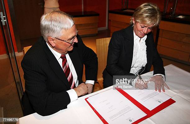 Silvia Neid headcoach Women German National Team signes a new contract with President of the German Football Association Theo Zwanziger during the...