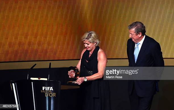 Silvia Neid of Germany receives the FIFA women's coach of the year trophy during the FIFA Ballon d'Or Gala 2013 at the Kongresshalle on January 13...