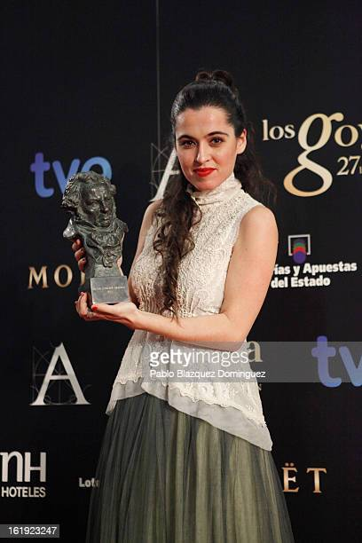 Silvia Perez Cruz holds her award for Best Original Song in the film 'Blancanieves' during the 2013 edition of the 'Goya Cinema Awards' ceremony at...