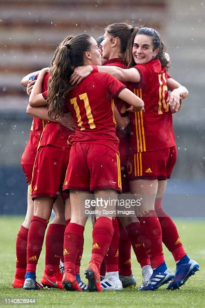 Silvia Rubio of Spain celebrates with her team mates after scoring her team's first goal during the UEFA Women's U19 European Qualifier match between...