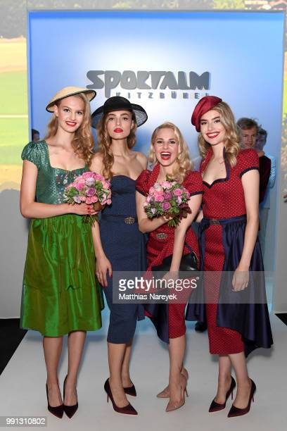 Silvia Schneider poses with models at the Sportalm Kitzbuehel show during the Berlin Fashion Week Spring/Summer 2019 at ewerk on July 4 2018 in...