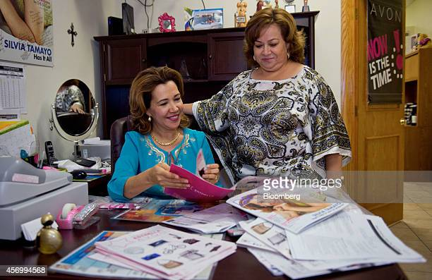 Silvia Tamayo a senior executive unit leader for Avon Products Inc and Isabel Hernandez unit leader and independent sales representative for Avon...